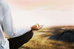 Man meditating in peaceful countryside